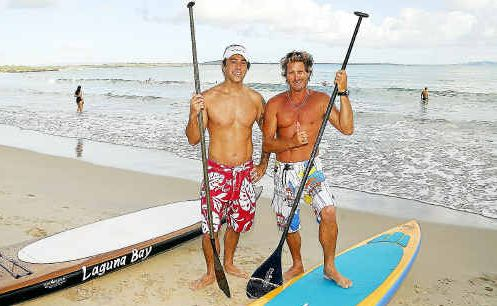 In happier times Woogie Marsh (left) and Chris de Aboitiz were pictured preparing to hit the surf on their stand up boards.