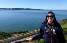 Johanna Stevens in front of San Francisco's Golden Gate Bridge, and right, the evidence of a great shopping expedition as the tour group snapped up bargains thanks to the strong Aussie dollar.