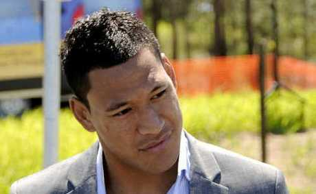 Aussie Rules convert Israel Folau talks with media after having a street named after him in Goodna.