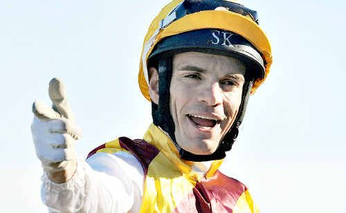 Stathi Katsidis celebrates his win riding Shoot Out in the AJC Australian Derby.