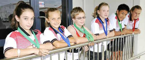 Medal winning athletes Georgia Hamilton, Rebecca Greiner, Nathaniel Edwards, Nikita Taylor, Rhys Lu and Jane Lester.