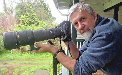Photographer Martin Jacka looking out for wildlife from his front verandah.