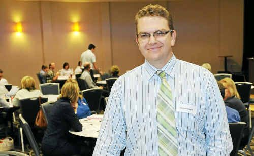 Michael Waters is ready to speak at an employment law seminar yesterday.