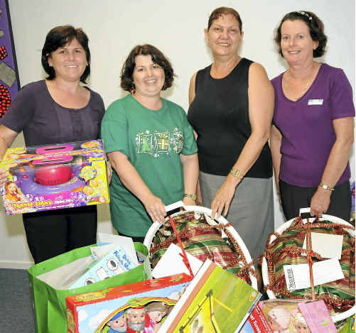 Leanne Montgomery, Diane Trevorton (The Observer), Valerie Dempsey and Wendy Mannell from Lifeline with items for Adopt-a-Family.