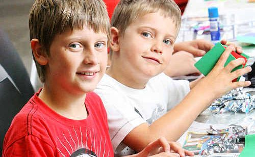 Jayden and Lachlann Radloff get busy at the Bazil Grumble workshop at the Queens Park Educational Centre.