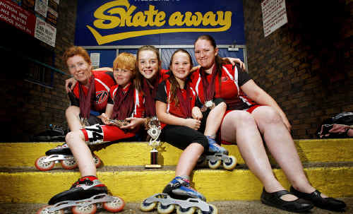 Ipswich skaters, from left, Linda Wild and her son Mark, 11, Jade Warren-Baskerville, 14, and Sharon Hurst, right, and her daughter Courtney, 8, are all smiles after starring at the Queensland Speedskating Championships.