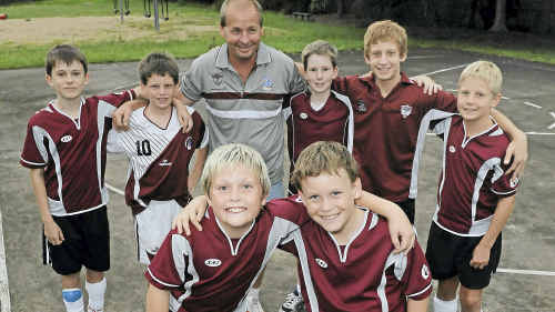Futsal stars (front) Ty Appleton and Connor Morrison, (back) Mitchell Laughlin, Chase Connelly, coach Troy Appleton, Joshua Adcock, Nicholas Chippendale and Evan Caville.