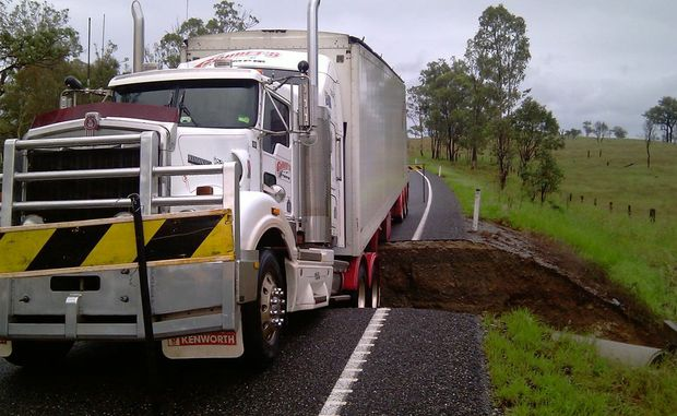 Corbets transport truck stuck on Wide Bay Highway north-west of Gympie, after the road gave way under the vehicle near Serpentine Creek.