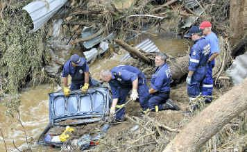 NSW Fire Brigade Recovery team locates Sylvia Baillie's car which was buried in the riverbed.