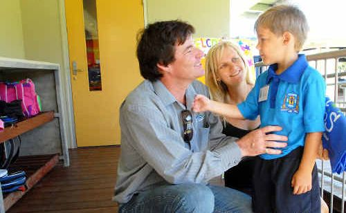 Anthony and Julie Kliese say goodbye to their son, Pierce, 6, who started Year 1 at Victoria Park State School yesterday.