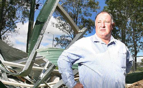 Lockyer Valley Regional Council mayor Steve Jones looks over damage in Helidon after last month's devastating floods.