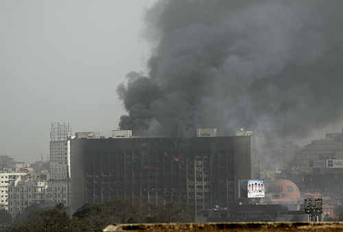 David Skennerton photographed a burning government building from the Cairo hotel they were staying in during anti-government protests.