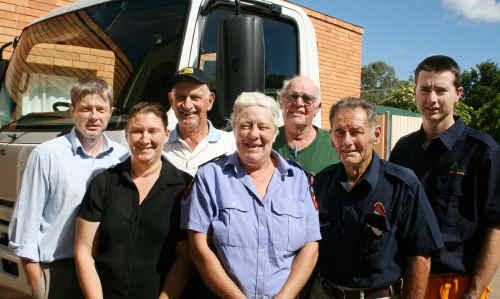 Grantham rural fire fighters, from left, Andrew McLoughlin, Mar Purton, Wally Riemer, Vivienne Jamieson, Peter Ingold, Geoff King and Anthony MacDonald with the new truck. Photo: Chris Smith