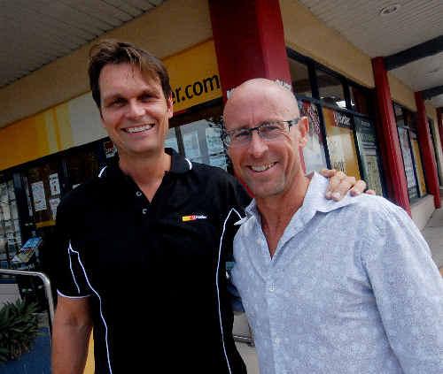 L Janusz Hooker and Des Besanko outside the LJ Hooker office in Wellington Street.