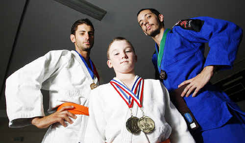 Ipswich Central Judo Club martial artists (from left) Luke Maczyszyn, Logan Spark and Sam Landy recently won state medals in Brazilian jiu-jitsu.