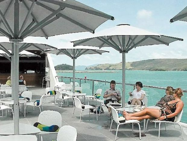 Relaxing on the long deck at Hamilton Island's yacht club, which has been nicknamed 'the opera house of Queensland'.