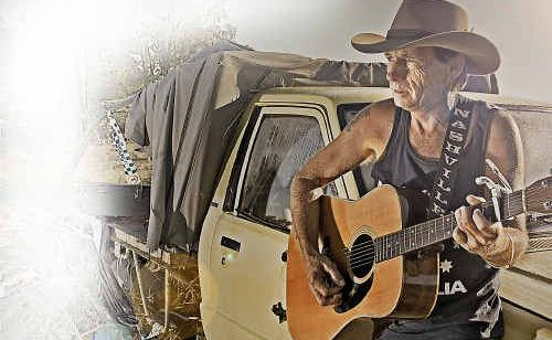 Beau Rivers strums the guitar that was returned to him after the flood.