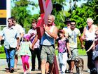 John Van De Leur and a group of Christians carry a cross from Tweed City to Jack Evans Boat Harbour.