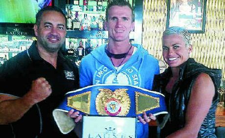 Adam Hollioake (left) seen here with WBF super middleweight champion Les Sherrington and Hayley Bateup.