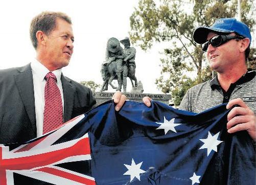 Jason Blake gets an Australia flag from Luke Hartsuyker.