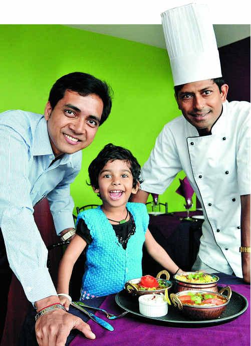 Sajal Barua (left) and award-winning chef Shaikh Akbar Ali, with his daughter Sumaiya, 3, look forward to welcoming customers to their new restaurant at Burnside.