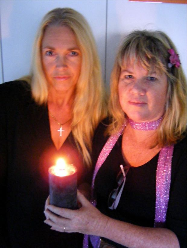 Karen Marsh and Lisa Price remember those lost to domestic violence during a candlelight service.