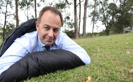 GOOD NIGHT: John Paul College Headmaster Warren Peat gets ready to take part in the St Vincent de Paul CEO Sleepout.