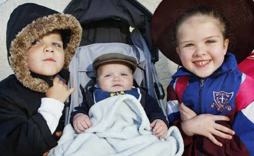 Feeling the cold are Ipswich kids (from left), Jordan, 4, Steffarn, 9 months, and Mackenzie Naoum, 6.