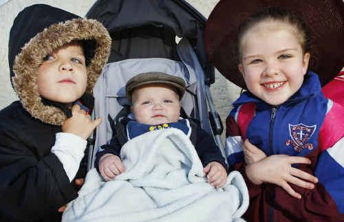 Feeling the cold are Ipswich kids (from left), Jordan, 4, Steffarn, 9 months, and Mackenzie Naoum, 6.