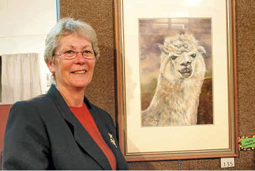 Artist Narell Webber beside her alpaca painting entry, highly commended in the Animalia section.