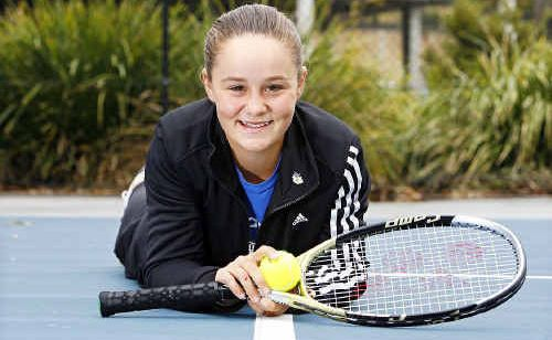 Junior Women's Wimbledon champion Ashleigh Barty lies on the Springfield Lakes Tennis Court now named after her to honour her recent victory.