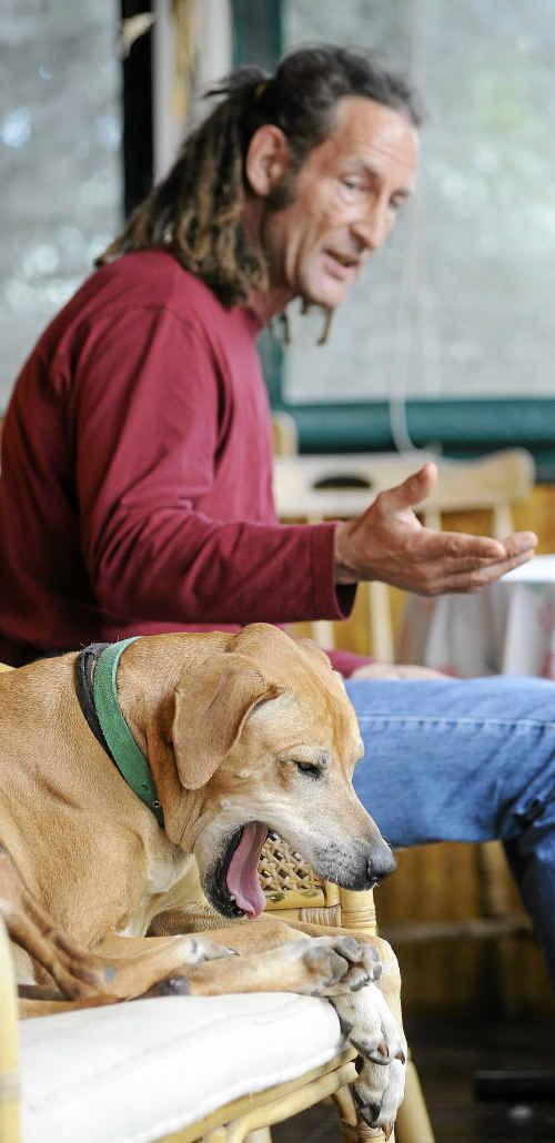 Australia's top dog communicator Martin McKenna sits with his mate Firefly.