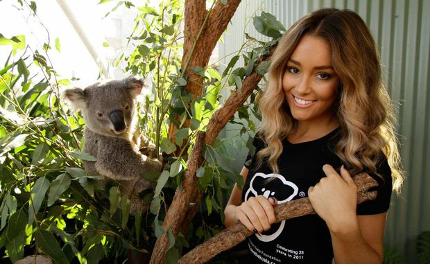 Erin McNaught with a furry friend at Sydney Wildlife World.