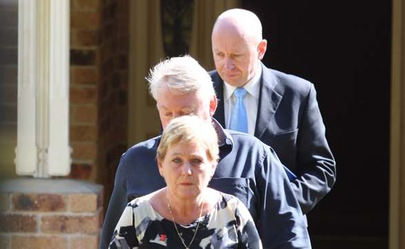 Bruce and Denise Morcombe emerge from their home with senior police.