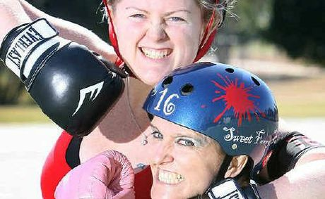 Florence Fightingale and Sweet Fanny Adams ham it up ahead of the smack down roller derby bout to be held on Saturday.