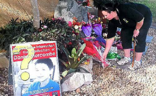 Talitha Stirling, of Beerwah, lays flowers at the site where Daniel Morcombe was abducted.