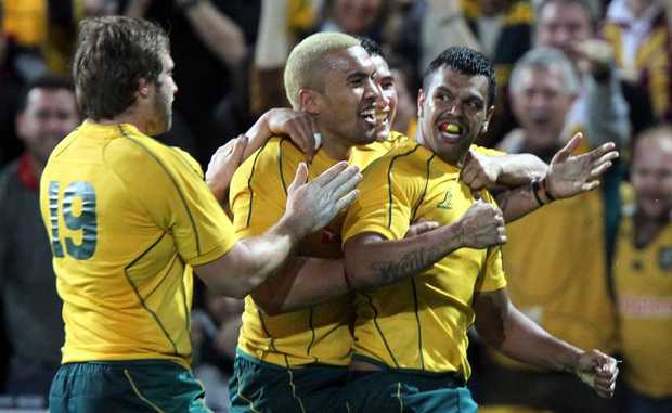 Wallabies team-mates congratulate Kurtley Beale (far right) during his last outing for the national team.