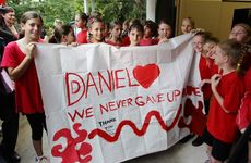 WOOMBYE State School students show their support for Daniel Morcombe during a visit to the school by Daniel's parents Bruce and Denise Morcombe.