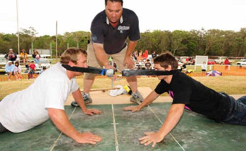 Lachlan Brooke of Tallebudgera takes on Joe Smith of Coffs Harbour under the watchful eye of judge Wayne Phillips at the Australian Goanna-Pulling Championships.