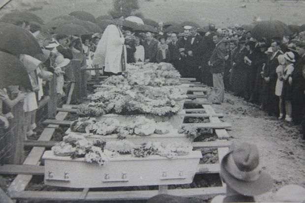 The nine caskets waiting burial side by side at South Grafton Cemetery - from camera, Bobby, John, Graeme, Billy, Brian, Dale, Sono, Toby & Ray (Daily Examiner)