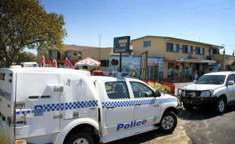 Police vehicles parked outside Brooms Head General Store yesterday after a 43 year-old woman was found deceased in the units at the rear of the shop.