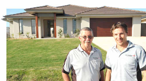 Neil and Rick Fischer of Grafton GJ Gardner Homes outside one of their display homes.
