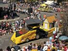 Thousands of people from all over the country lined city streets under brilliant sunshine to witness Saturday's Grand Central Floral Parade, including the colourful USQ float.