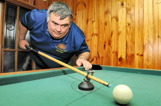 Coral Coast Men's Shed president Michael Garrett invented this pool cue-holding device.