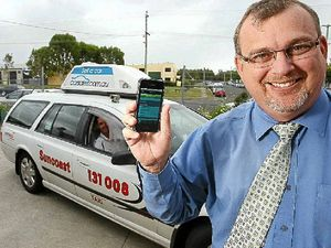Suncoast Cabs general manager John Lobwein with the app for iphones and ipads, launched in 2011.