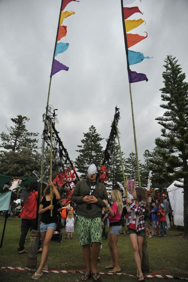 Connor Dwyer is guided through the flags at the end of the parade at the Surfing the Coldstream Festival held in Yamba on Saturday afternoon. Photo: JoJo Newby/The Daily Examiner