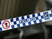 A WOMAN remains in a critical condition after she was stabbed in her Torquay home on Saturday night.