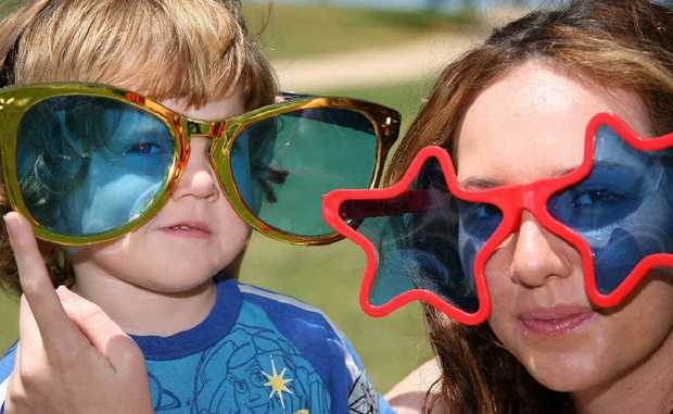 Austin Skinner, 3, and Paige Skinner try on some funky sunglasses as part of Sunnies Day.