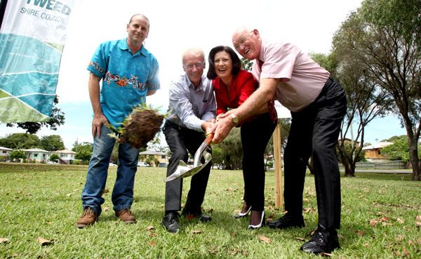 Turning the first sod of the community centre last year.