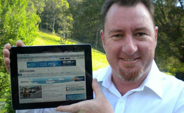 Coffs Coast Advocate general manager Brent Rees shows off the newspaper's website, where you can stay up to date with all the latest local news 24-7.
